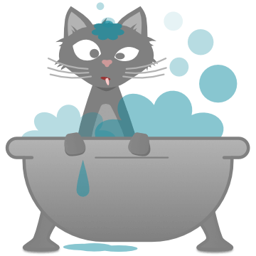 A cat getting a bath in a bathtub